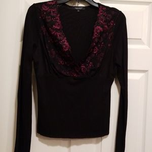 Black blouse with red lace flowers around the neck